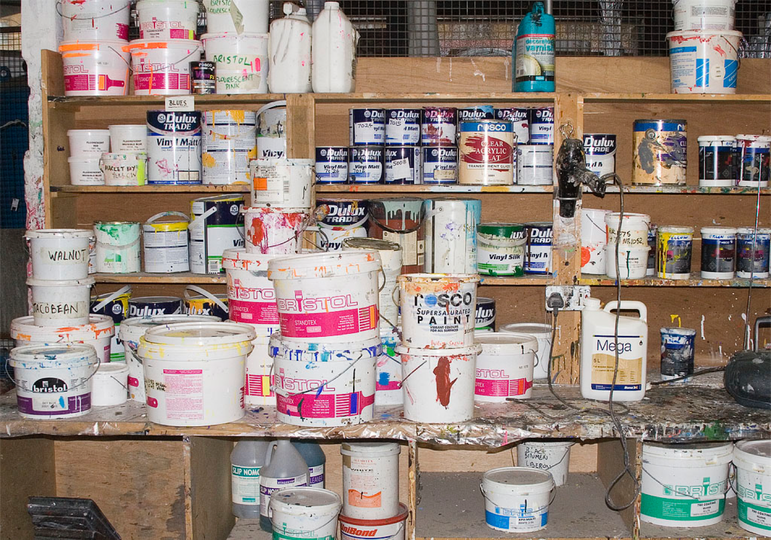 Photograph showing shelves holding the stocks of various paint colours and types in the paint room at the National Theatre (credit: Hilary Vernon-Smith)