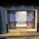 Colour photograph showing a three-dimensional model of the design by Mark Thompson for a traditional set with sliders and cloths for the production of One Man, Two Governors at the National (copyright National Theatre/Hilary Vernon-Smith)