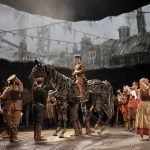 Colour photograph showing the combination of scene painting and new technology (such as projection, video or animation) in a scene from the National's production of War Horse (copyright National Theatre/Hilary Vernon-Smith)